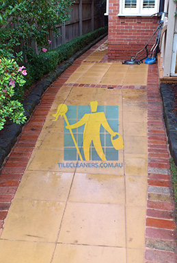 outdoor sandstone tiles pavers wet from cleaning with quarry tiles around Sydney